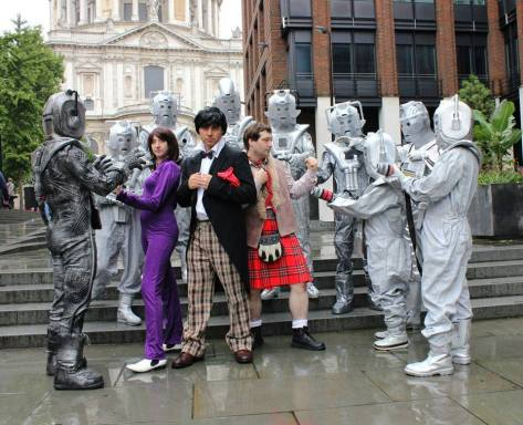 Cosplayers: Shawn Levy, Cosmic Cosplayl, Alan Fry Peters, Joey Indiana Peter Green, Ash CyberShock, Andrew Julian Wishart Characters: Second Doctor, Zoe, Jamie and Cybermen. Photo: Andy Lambert  The Cybermen surround the Doctor and his companions.